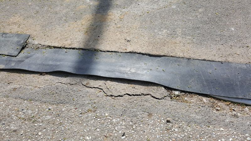 Crack and hole in road that needs fixing